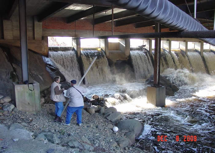 Two People Underneath Armstrong Dam